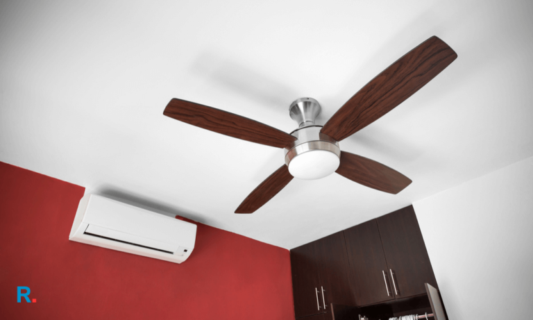best ceiling fan in india hanging in ac room with red wall