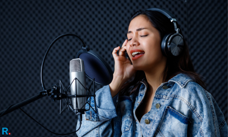 singer siwomen singing a song using best studio headphones in india in a sound mixing studio